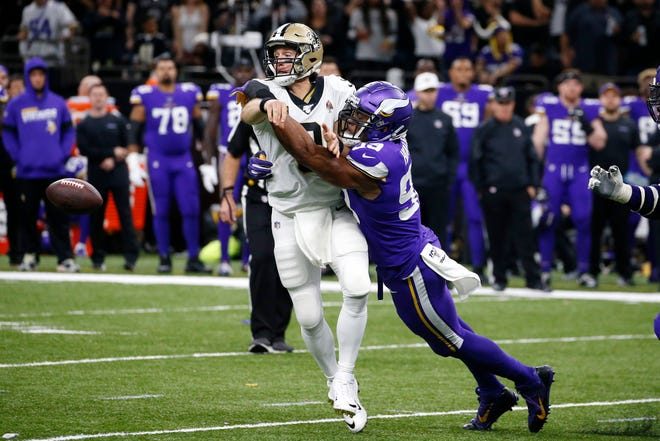 FILE - In this Sunday, Jan. 5, 2020, file photo, New Orleans Saints quarterback Drew Brees (9) fumbles as he is hit by Minnesota Vikings defensive end Danielle Hunter (99) in the second half of an NFL wild-card playoff football game in New Orleans. The Vikings have emerged from their bye week down two starting defensive ends, after a salary-dump trade of Yannick Ngakoue and a season-ending surgery for Danielle Hunter. (AP Photo/Butch Dill, File)