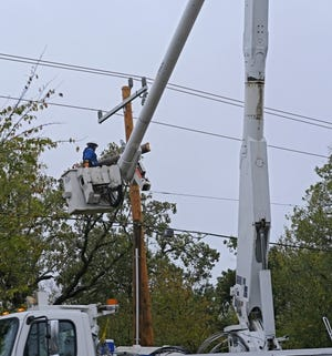 Edmond Electric works to restore electric power along South Boulevard in Edmond Tuesday, October 28, 2020. [Doug Hoke/The Oklahoman]