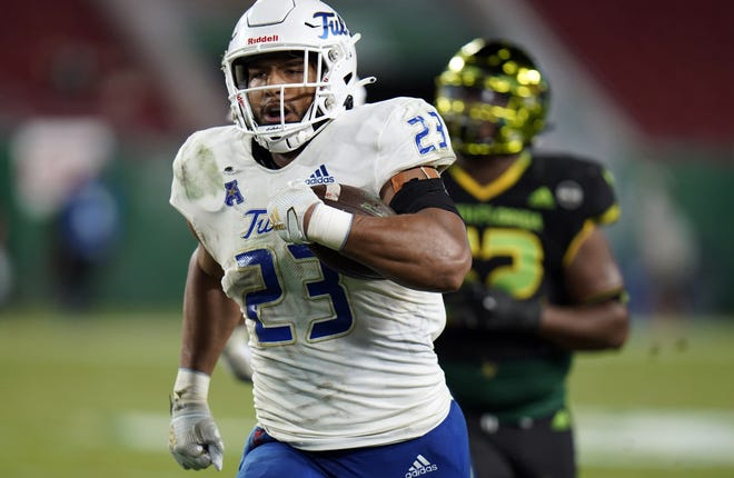 Tulsa linebacker Zaven Collins (23) runs back an interception for a touchdown against South Florida last Friday in Tampa, Fla. [AP Photo/Chris O'Meara]