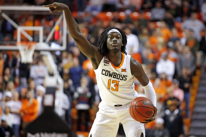 Oklahoma State's Isaac Likekele (13) gestures during an NCAA basketball game between OSU and Texas at Gallagher-Iba Arena in Stillwater Jan. 15. [Bryan Terry/The Oklahoman]