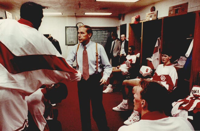 Oklahoma head coach Billy Tubbs shakes hands with each of his players shortly before the tipoff of a game in 1990. [OKLAHOMAN ARCHIVES]
