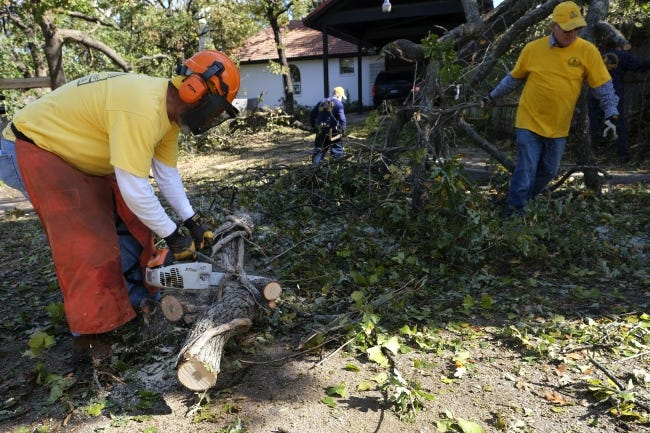 An Oklahoma Baptists Disaster Relief team works on tree limb removal at a house in Bethany on Friday. [Doug Hoke/The Oklahoman]
