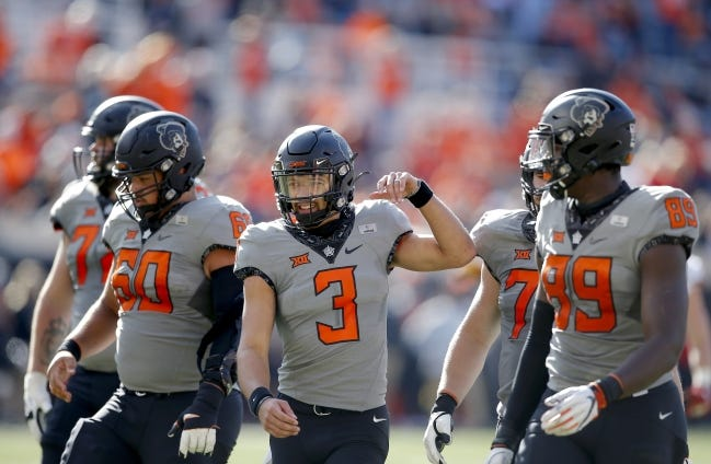 OSU quarterback Spencer Sanders (3) completed 20 of 29 passes for 235 yards in a 24-21 victory over Iowa State.   [Sarah Phipps/The Oklahoman]