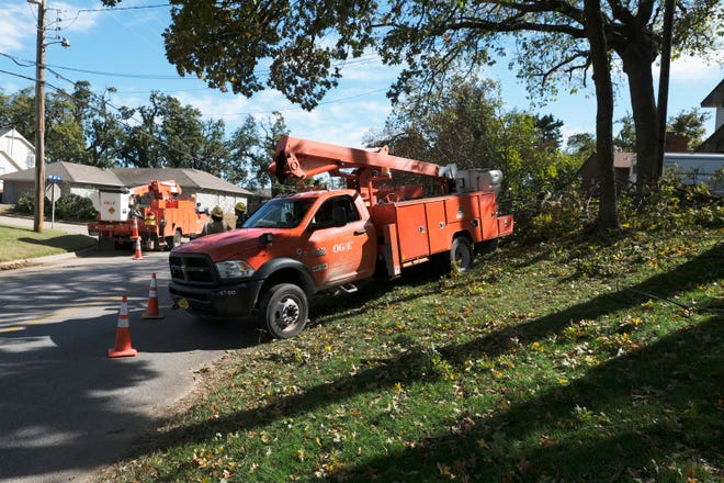 OG+E crews work to restore power in the area of NW 30th and N. Briarwood in Bethany, Friday, October 30, 2020. [Doug Hoke/The Oklahoman]