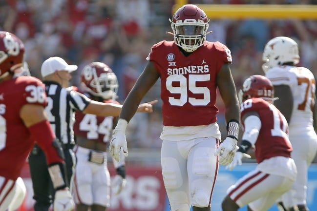 Oklahoma's Isaiah Thomas (95) celebrates after a fumble recovery during the Red River Showdown on Oct. 10 in Dallas, a 53-45 win over Texas in four overtimes. [Bryan Terry/The Oklahoman]