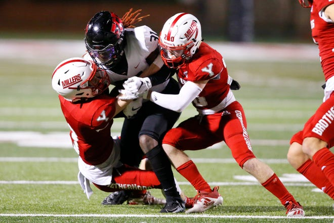 Westmoore's Brandon Arnold is brought down by Yukon's Keaton Hahn, left, and Cody Pfieffer during a high school football game between Yukon and Mustang in Yukon Okla., Friday, Oct. 30, 2020. [Bryan Terry/The Oklahoman]