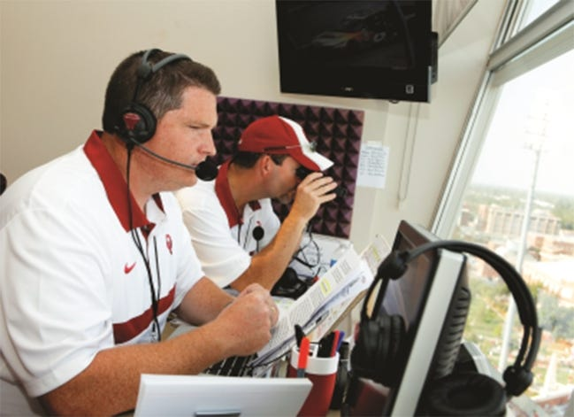 Greg Blackwood, right, provides all sorts of information as the spotter to OU radio play-by-play man Toby Rowland. But most of their communication is non-verbal as they developed a set of hand signals over their decade together. [PHOTO PROVIDED]