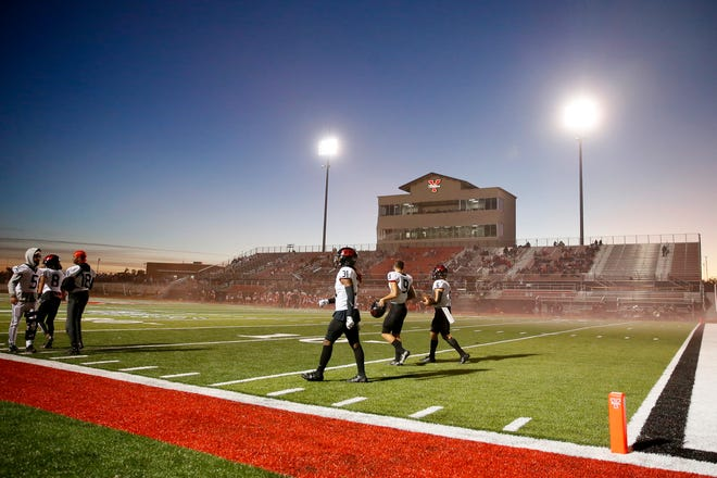 Westmoore players walk across the field before a high school football game between Yukon and Mustang in Yukon Okla., Friday, Oct. 30, 2020. [Bryan Terry/The Oklahoman]