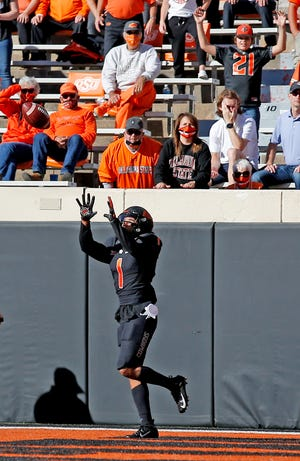 Oklahoma State's Landon Wolf (1) catches a touchdown pass in the first quarter during the college football game between the Oklahoma State University Cowboys and the University of Texas Longhorns at Boone Pickens Stadium in Stillwater, Okla., Saturday, Oct. 31, 2020. Photo by Sarah Phipps, The Oklahoman