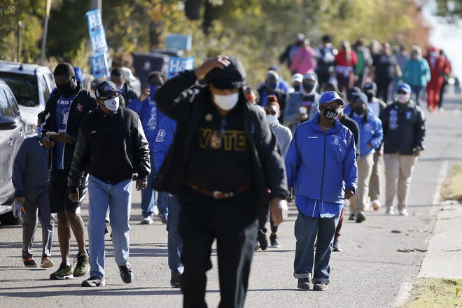 """A crowd marches along NE 42 to the Oklahoma County Election Board as part of the """"Souls to the Polls"""" voter turnout initiative on Saturday in Oklahoma City. [Bryan Terry/The Oklahoman]"""