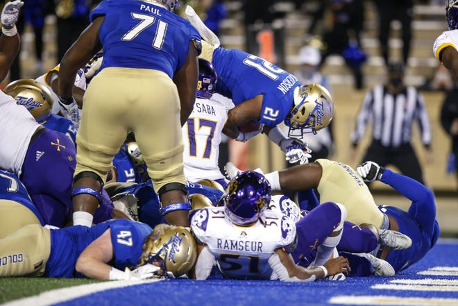 Tulsa running back TK Wilkerson (21) leaps into the end zone for the go-ahead touchdown with under a minute left during a 34-30 win over East Carolina on Friday. [Ian Maule/Tulsa World]