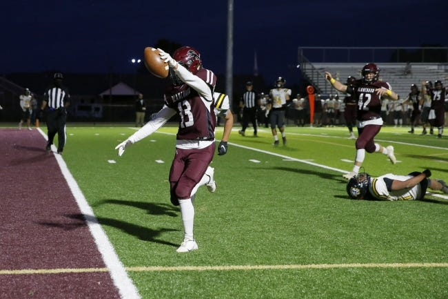 Blanchard's Lincoln Smith scores a touchdown against Tecumseh on Oct. 15. [Bryan Terry/The Oklahoman]