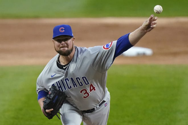 Jon Lester, shown here pitching for the Chicago Cubs, is buying beers for Cubs fans to show his appreciation during his stay with the National League team. So far, more than 3,400 beers have been put on Lester's tab. [AP Photo/Nam Y. Huh]