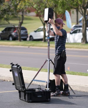 """A crew member works on the set of the Oklahoma film """"Out of Exile"""" at the Flamingo Apartments on NW 23 St. Thursday, October 15, 2020. [Doug Hoke/The Oklahoman]"""