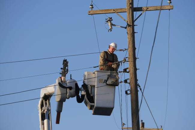 A crew from Power Grid Services, in Hartselle, Alabama, works on N Laird Avenue near NE 24 Street to restore power in the area Monday. [Doug Hoke/The Oklahoman]