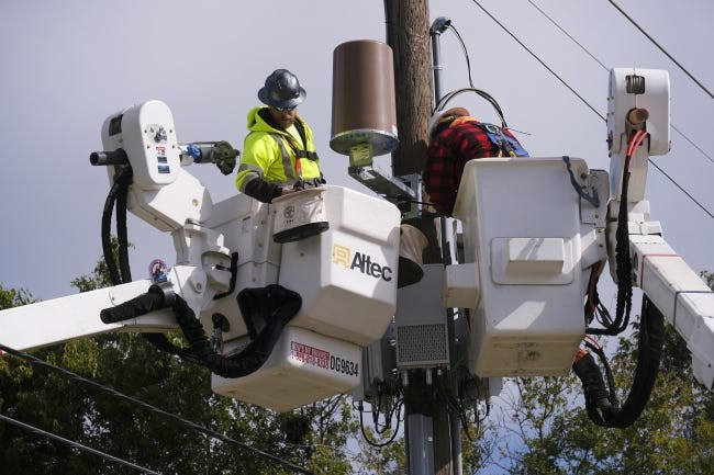 Crews work late last week to restore power on Lincoln Boulevard in Oklahoma City. OG&E estimates it should have power fully restored in the metro by the end of the weekend. [Doug Hoke/The Oklahoman]