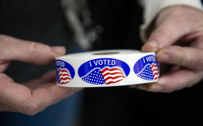 Stickers are prepared for voters after they cast their ballots at the United Methodist Church of the Good Shepherd in Yukon on Tuesday. [Chris Landsberger/The Oklahoman]