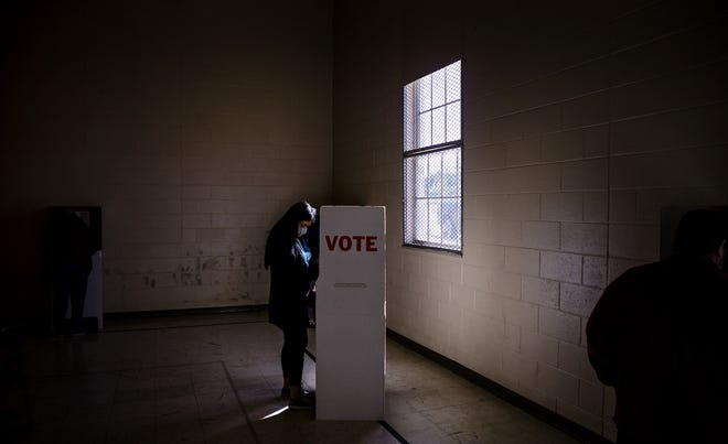 A voter fills out her ballot Tuesday at Mayridge Baptist Church in Oklahoma City. [Chris Landsberger/The Oklahoman]