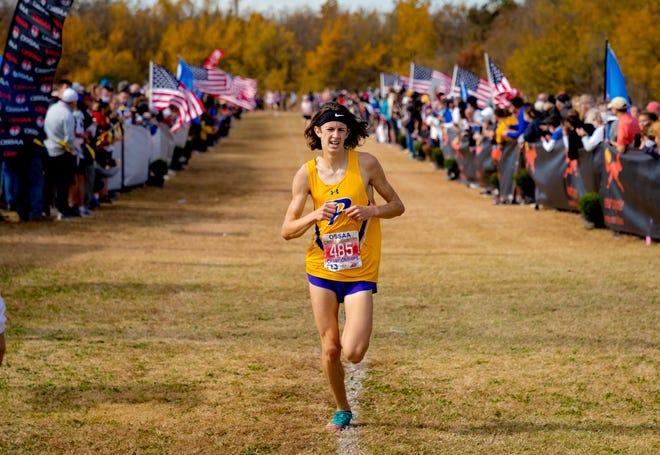 Piedmont's Beckham Hartis (485) runs to the finish line during the 5A boys cross country state championships at Edmond Santa Fe High School in Edmond, Okla. on Wednesday, Nov. 4, 2020. [Chris Landsberger/The Oklahoman]