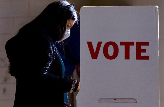 A voter fills out her ballot at the Mayridge Baptist Church in Oklahoma City, Okla. on Tuesday, Nov. 3, 2020. [Chris Landsberger/The Oklahoman]