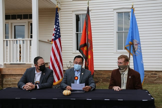 Cherokee Nation Principal Chief Chuck Hoskin Jr. signs as Deputy Principal Chief Bryan Wagner, left, and Tad Jones of the Oklahoma Historical Society look on during a transfer ceremony at the Will Rogers Birthplace Ranch in Oologah on Wednesday. The ceremony was held to formalize the Cherokee Nation's acquisition of the museum from the Oklaoma Historical Society. [Photo provided]