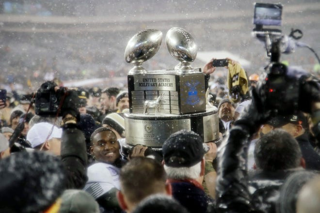 FILE - This Dec. 9, 2017, file photo shows Army's Ahmad Bradshaw holding up the Commander-in-Chief's Trophy after Army defeated Navy in an NCAA college football game in Philadelphia. Army coach Jeff Monken is focused on one thing _ capturing the Commander-in-Chief's Trophy. The Black Knights can take the first step toward winning the coveted hardware, emblematic of supremacy among the three service academies, when Air Force visits Michie Stadium on Saturday, Nov. 7, 2020. (AP Photo/Matt Rourke, File)