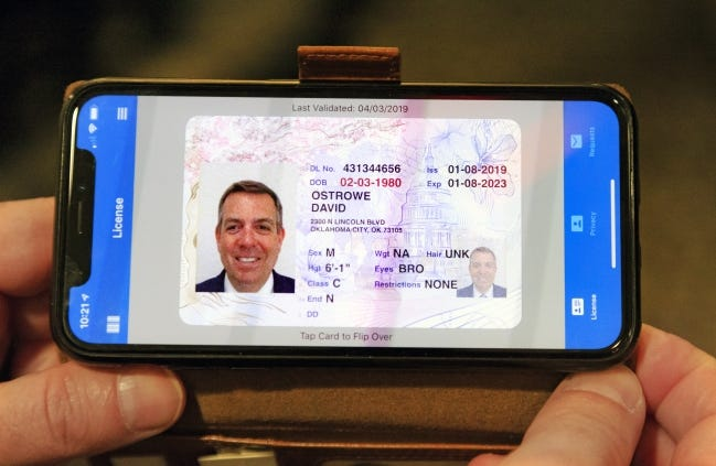 Secretary of Digital Transformation and Administration David Ostrowe shows an example of Oklahoma's mobile ID app on his phone last year. Since its introduction, about 50,000 Oklahomans have downloaded the app. [CHRIS LANDSBERGER/THE OKLAHOMAN]