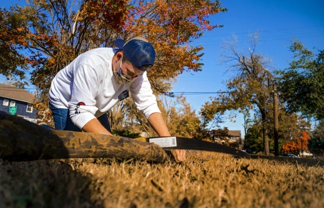 Summit Grace, a Church of Jesus Christ of Latter-day Saints missionary, works alongside other missionaries on Friday to clean up storm damage at Perle Mesta Park, 1900 N Shartel. [Chris Landsberger/The Oklahoman]
