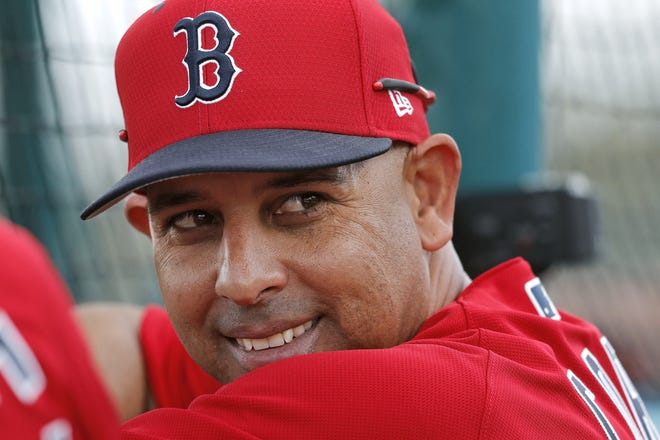 The Boston Red Sox rehired Alex Cora as manager on Friday, less than a year after letting him go because of his role in the Houston Astros cheating scandal. [AP Photo/Gerald Herbert, File]