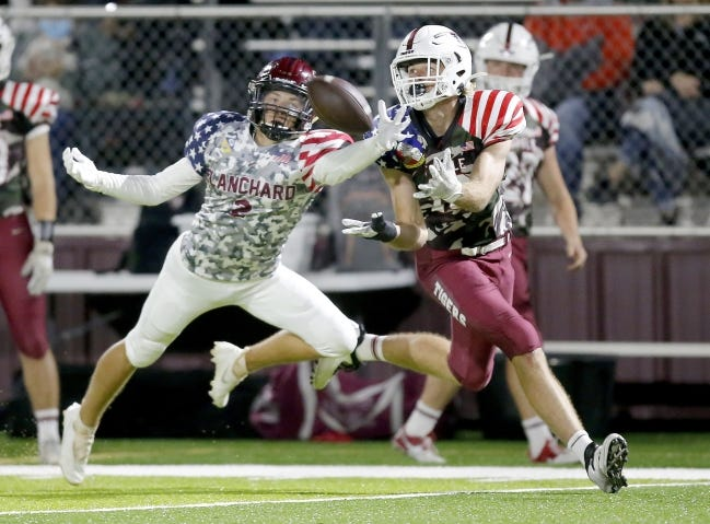 Tuttle's Mason Stokes makes a reception as Blanchard's Whit Carpenter defends during the high school football game between Blanchard and Tuttle at Blanchard High School in Blanchard, Okla., Friday, Nov. 6, 2020. [Sarah Phipps/The Oklahoman]
