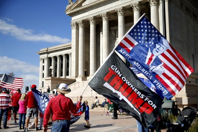 Flag-waving suporters of President Donald Trump gather during a rally Saturday at the state Capitol in Oklahoma City. [Sarah Phipps/The Oklahoman]