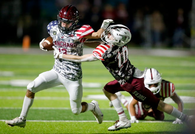 Blanchard's Lincoln Smith stiff arms Tuttle's Dillon Ballard during Friday's game in Blanchard. [Sarah Phipps/The Oklahoman]