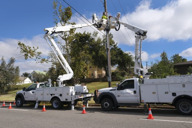 In this Oct. 29 photo, workers restore power near NE 16 and Lincoln Boulevard after ice storms caused widespread outages in the Oklahoma City metro. [Doug Hoke/The Oklahoman]