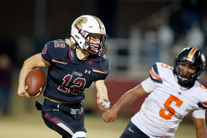 Cashion's Ben Harman scrambles during a game against Crescent in Cashion on Nov. 6. [Bryan Terry/The Oklahoman]