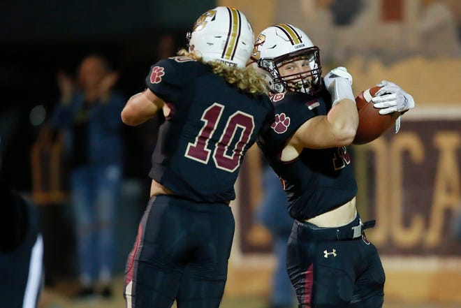 Cashion's Mason Manning, right, celebrates with Brexten Green during a game against Crescent in Cashion on Nov. 6. [Bryan Terry/The Oklahoman]