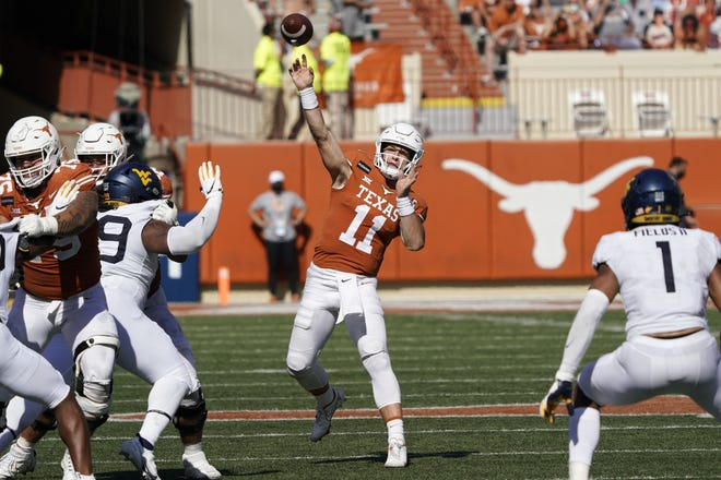 Texas' Sam Ehlinger (11) throws a pass against West Virginia in the Longhorns 17-13 win over the Mountaineers in Austin, Texas on Saturday. [AP Photo/Chuck Burton]