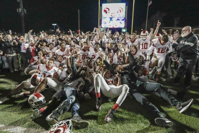 Owasso celebrates after defeating Jenks for the Class 6A-1 state championship last season in Edmond. [Alonzo Adams/For The Oklahoman]