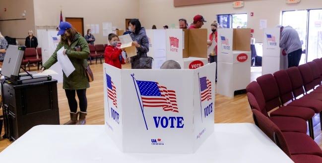Voters cast their ballots Nov. 3 at the International Pentecostal Assembly in Yukon. [Chris Landsberger/The Oklahoman]