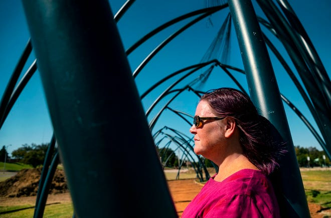 """Artist Romy Owens poses for a photo with her public art project """"Under Her Wing Was the Universe"""" in Enid, Okla. on Thursday, Oct. 17, 2019. [Chris Landsberger/The Oklahoman Archives]"""