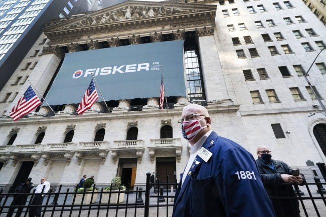 Stock trader Thomas Ferrigno arrives to work at the New York Stock Exchange on Monday. Many Oklahoma companies benefitted from a boost in market values Monday. [AP Photo/Mark Lennihan]