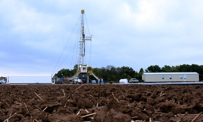 A rig drills a well for Chesapeake Energy in the West Edmond Field of the Anadarko Basin in 2008. Chesapeake announced this week that it has reached a potential deal with a local buyer to pick up its Mid-Continent assets. [THE OKLAHOMAN ARCHIVES]