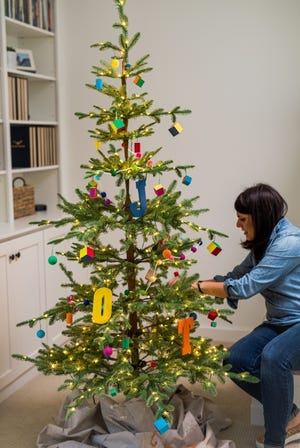"""Jennifer Lutz, of Hillsdale, Mich., decorated a Christmas tree for her four kids, ages 11 to 14, this year the day after Halloween. She put up the rest of her holiday decor, including two more trees, the following week. """"It gives us something to look forward to,"""" she said. [Provided/Jennifer Lutz]"""