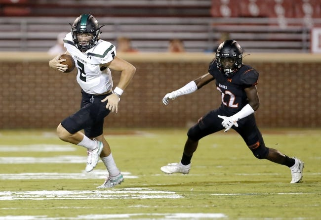 Norman North's Jackson Remualdo (2) rushes away from Norman's Jackson Caldwell during a game last year. The two schools will face off in the playoffs on Friday. [Sarah Phipps/The Oklahoman]