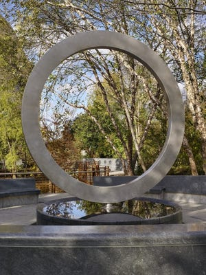 """The """"Warrior's Circle of Honor"""" design has as its focal point an elevated stainless-steel circle that symbolizes the cycles of life and death as well as unity among Native veterans.   Designed by Oklahoma artist Harvey Pratt (Cheyenne-Arapaho), the new National Native American Veterans Memorial is on the grounds of the Smithsonian Institution's National Museum of the American Indian. [Alan Karchmer/For the National Museum of the American Indian]"""
