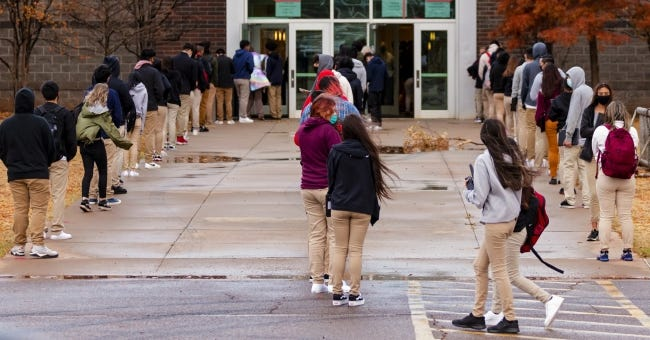 In this Nov. 10 photo, students wait in line to return to class at U.S. Grant High School in Oklahoma City. [Chris Landsberger/The Oklahoman]