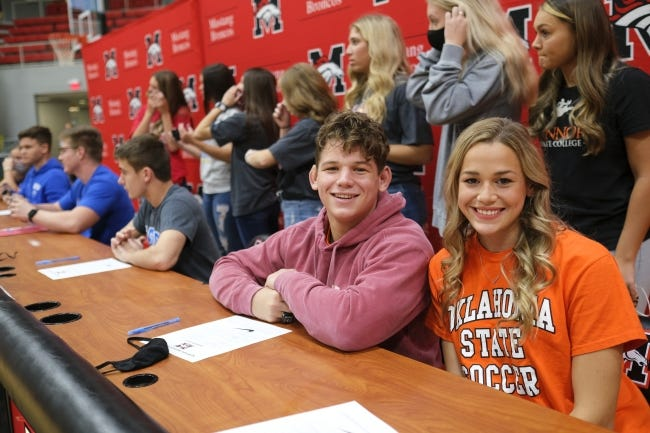 Twins Tate and Trinity Picklo pose for a photo Wednesday during a signing day ceremony at Mustang High School. Tate signed with OU wrestling. Trinity signed with Oklahoma State soccer. [Doug Hoke/The Oklahoman]