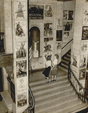 """Posters from World War I decorate the lobby of the Oklahoma City YWCA in November 1939 to commemorate Armistice Day. The posters encouraged buying U.S. government bonds, implored people to not waste food, and recruited men and women toward the war effort. Slogans included such anthems as """"Hold up your end!"""" """"The Red Cross counts on you,"""" """"I summon you to the comradeship"""" and """"Over the top for you."""" The banners were also considered works of art, created by artists and illustrators such as Jessie Willcox Smith, Neysa McMein and Howard Chandler Christy. [GEORGE CAUTHEN/THE OKLAHOMAN ARCHIVES] We are running a #ThrowbackThursday image each week, showcasing Oklahoma's history. Be sure to follow us on Twitter @TheOklahoman_ and """"Like"""" us at Facebook.com/TheOklahoman for more historical photos.   Linda Lynn, News Research Editor"""