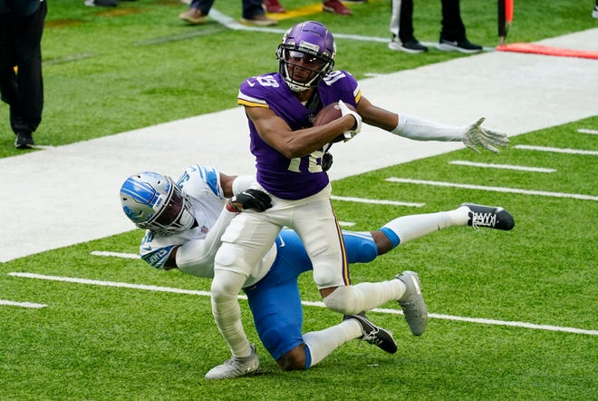 FILE - In this Sunday, Nov. 8, 2020, file photo, Minnesota Vikings wide receiver Justin Jefferson (18) runs from Detroit Lions cornerback Jeff Okudah after catching a pass during the first half of an NFL football game, in Minneapolis. There's no shortage of high draft picks making huge impact around the league, especially on offense with the instant success of players like Jefferson. (AP Photo/Jim Mone, File)