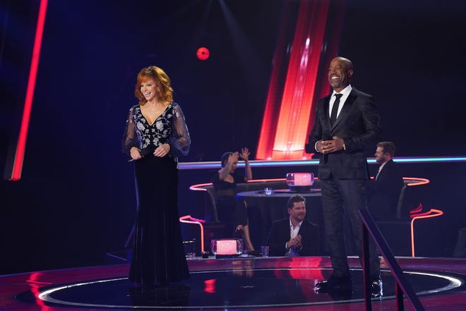 """Oklahoma native Reba McEntire and Darius Rucker co-hosted and performed """"In the Ghetto"""" on Wednesday's CMA Awards. [John Russell/CMA]"""