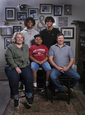 Edmond Santa Fe wide receiver Talyn Shettron is an Oklahoma commit. Standing left to right in the back row are Talyn and Tabry. Courtney, Trace and Trevor Shettron are on the front row. [Doug Hoke/The Oklahoman]
